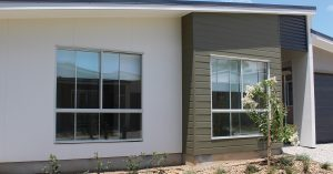 builders installing secondary glazing for windows inside Brisbane house