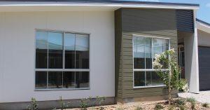 builders installing secondary glazing for windows inside Brisbane house