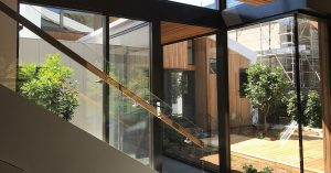 cheap double glazed windows and doors being installed inside stylish, modern home in Brisbane
