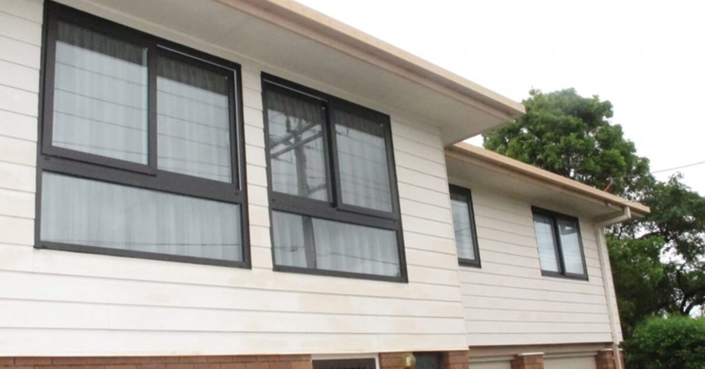Large uPvc double glazed windows to stop street noise from busy road in Brisbane city