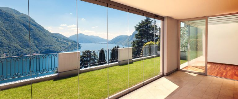 large frameless glass doors with double glazing to block noise and keep house cool in summer